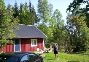 My Twin Sister infront of Our Cottage in Sweden